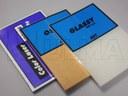 Materiały biurowe pakowane w folię termokurczliwą.